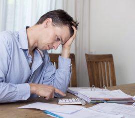 Man is feeling depressed on financial pressure.