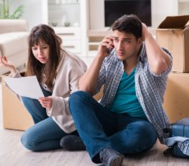 Worried young couple received foreclosure notice.